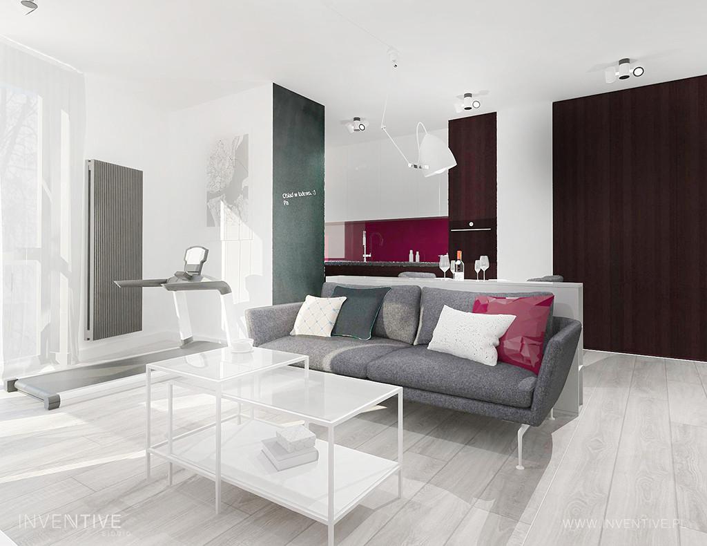 Salon z szarą sofą i białym stolikiem kawowym