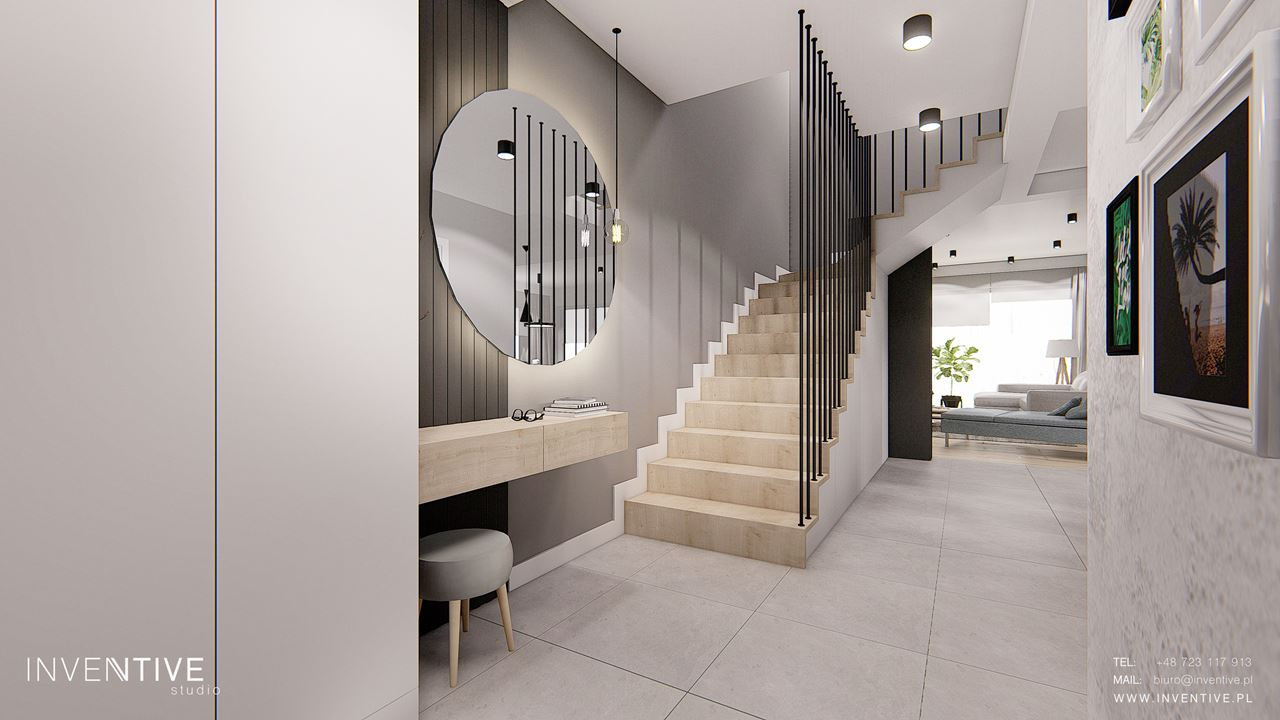 Przedpokój z betonem dekoracyjnym na ścianie
