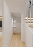 Małą łazienka w wnęce pod schodami