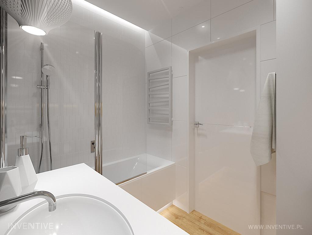 Łazienka z białymi kaflami na ścianie