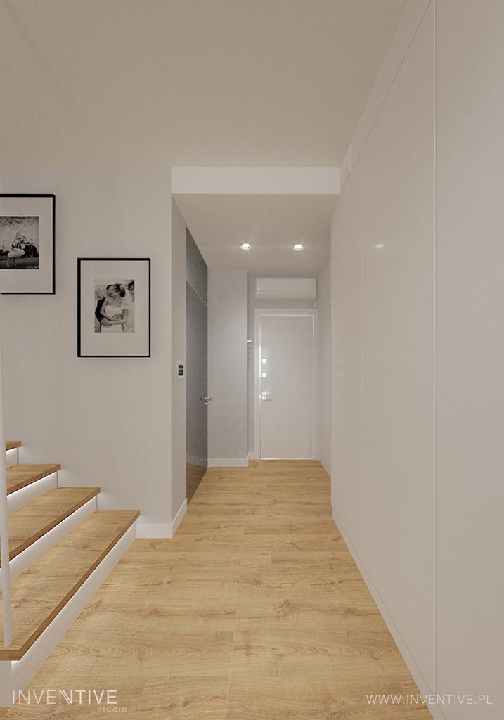 Biały przedpokój ze schodami