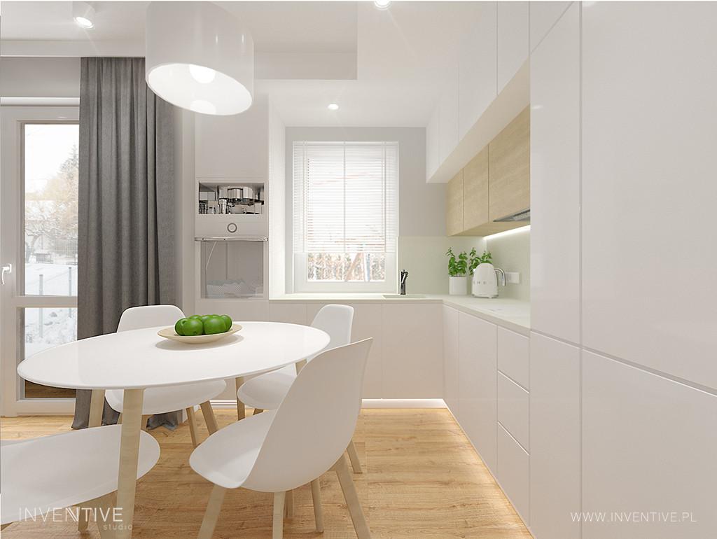 Biała kuchnia z akrylowymi frontami