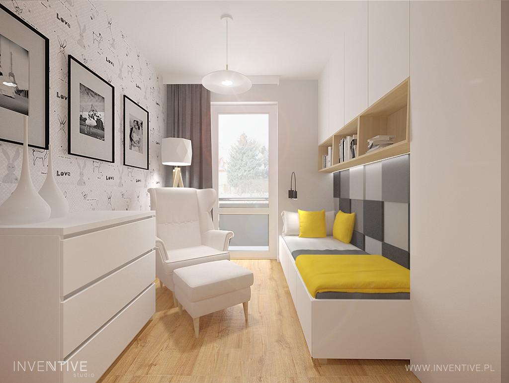 Pokój młodzieżowy z białym fotelem typu uszak