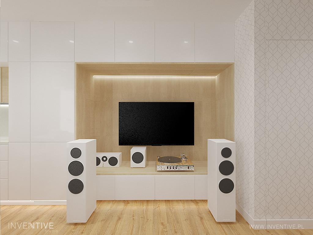 Biała ściana z wnęka na telewizor