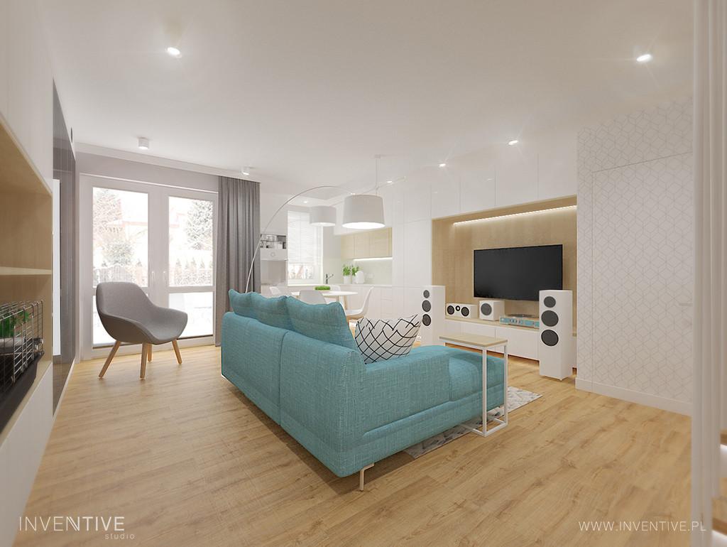 Biały salon z telewizorem i błękitnym narożnikiem