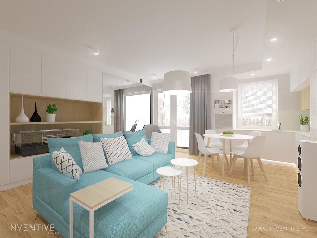 Biały salon w nowoczesnym stylu z błękitnym narożnikiem