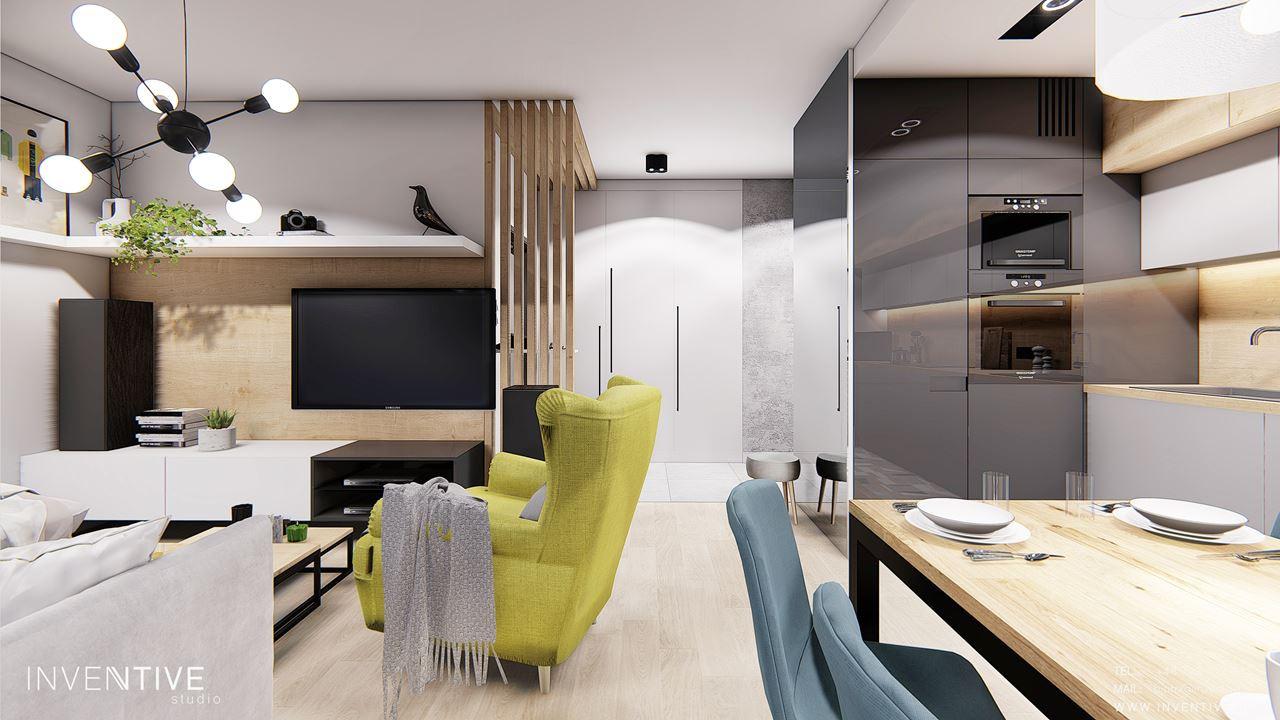 Aranżacja małego salonu z półką na ścianie