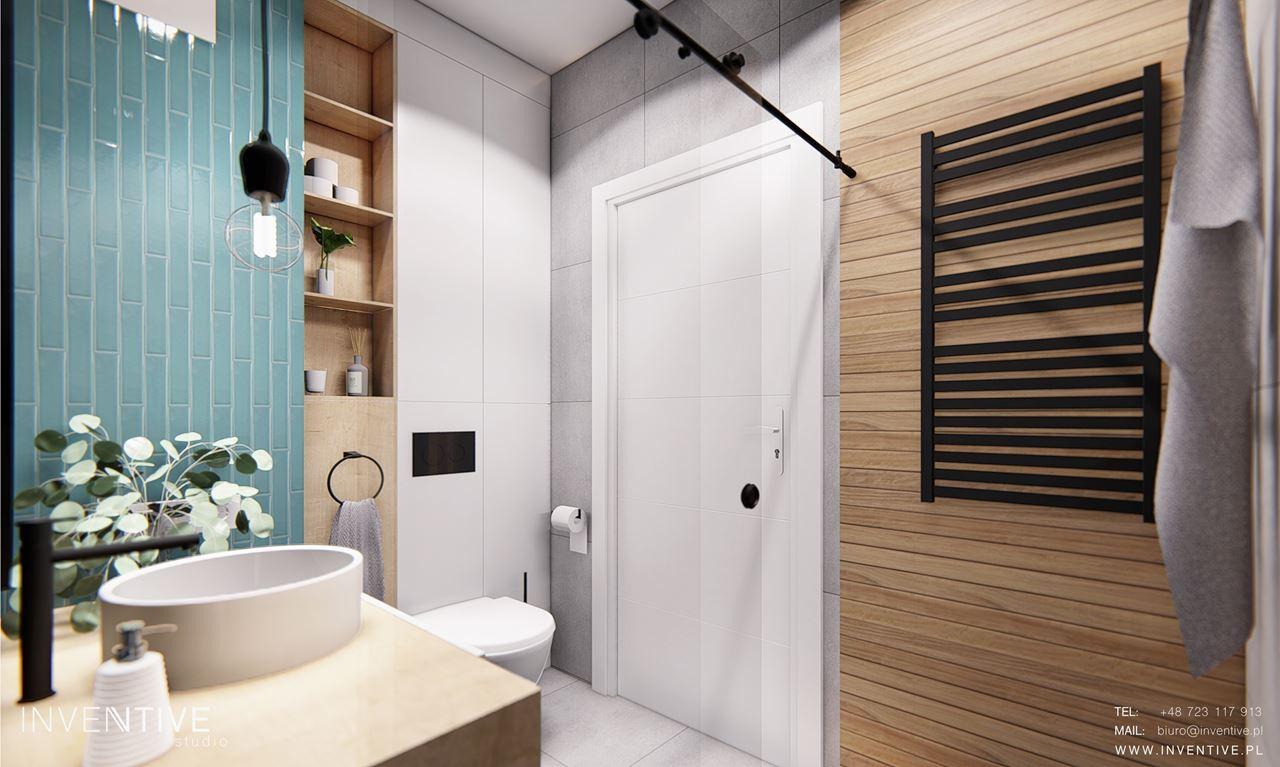 Projekt łazianki z czarnym kaloryferem na ścianie