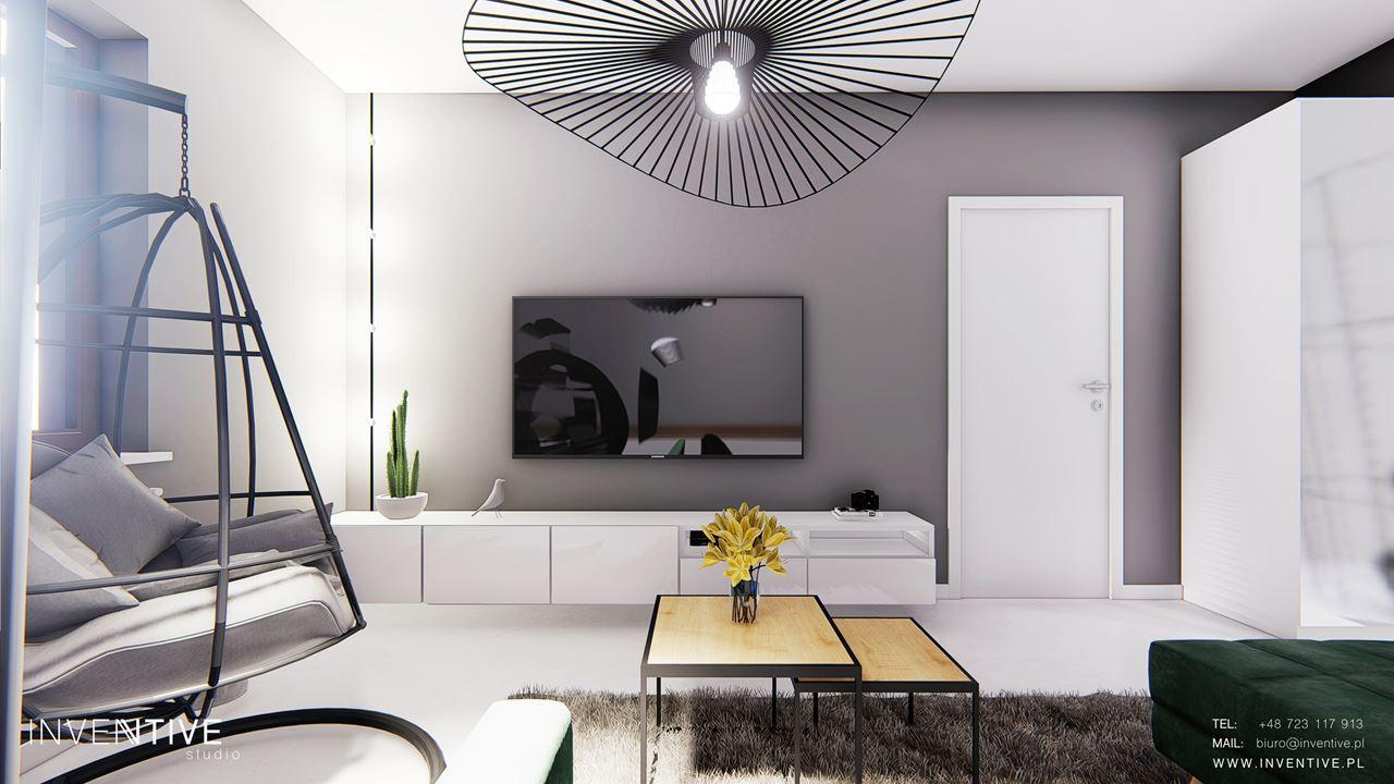 Biały salon ze stylowym żyrandolem