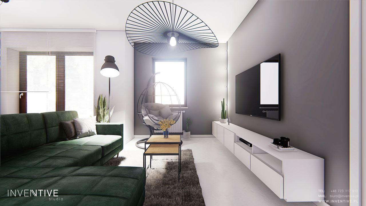 Salon z telewizorem i zielonym narożnikiem