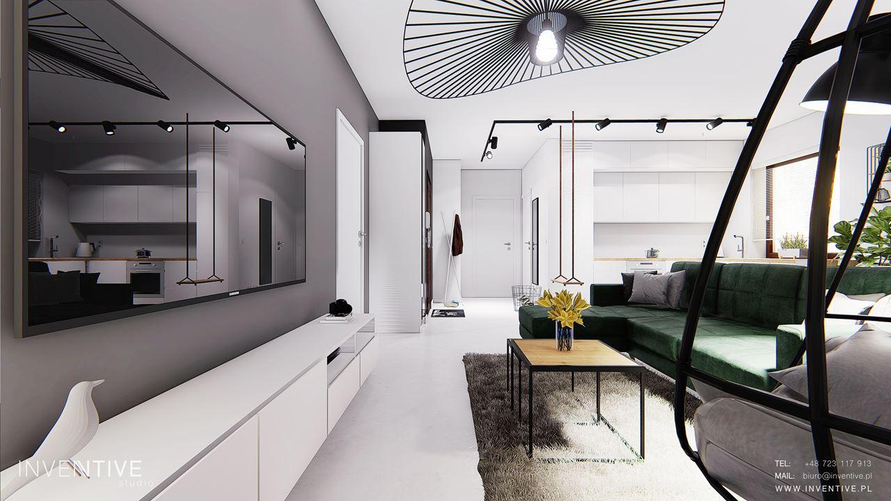 Salon z szarą ścianą z telewizorem
