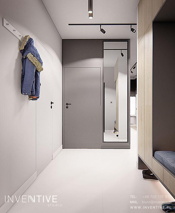 Aranżacja wejścia do mieszkania z lustrem