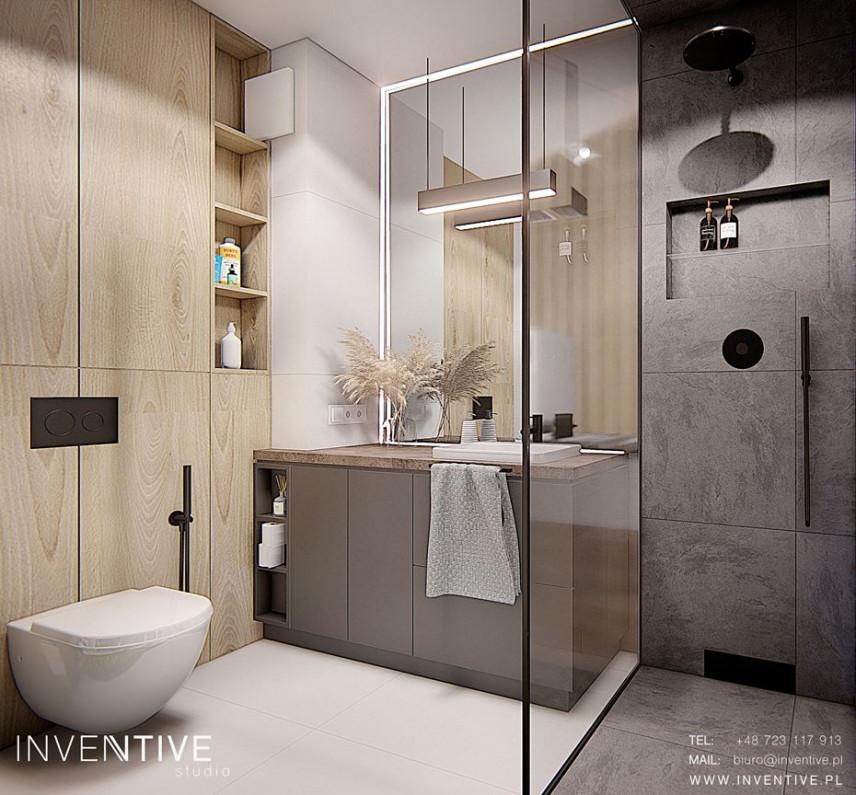 Projekt łazienki z szarą szafką stojącą