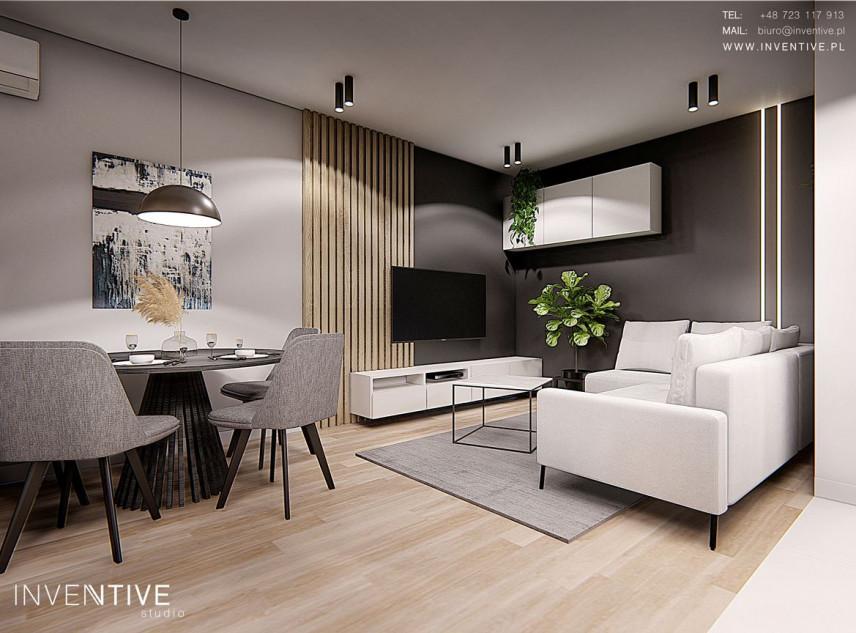 Projekt salonu z drewnem na ścianie