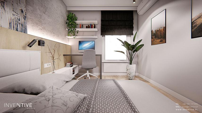 Projekt sypialni z miejscem do pracy i z betonem dekoracyjnym na ścianie