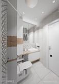 Białą łazienka z elementami drewna