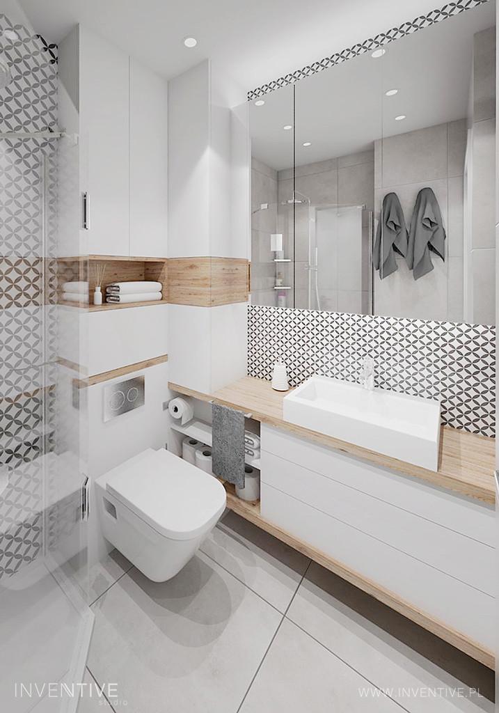 Biała łazienka z drewnianym blatem