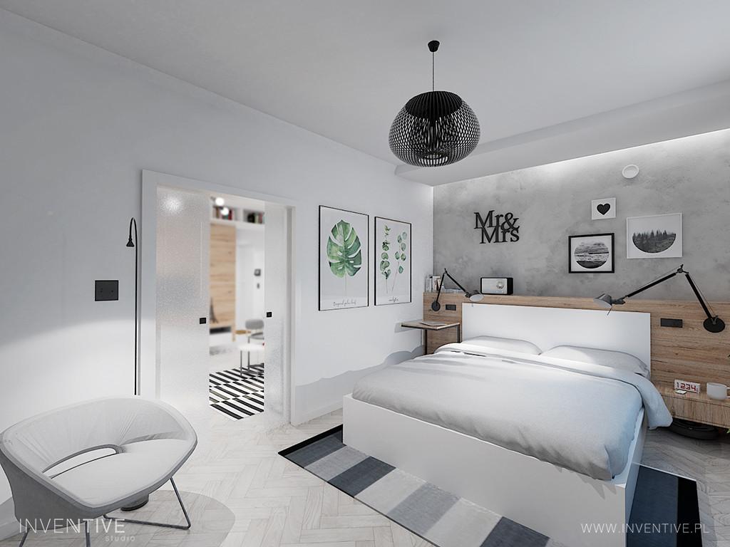 Biała sypialni ze ścianą z betonu dekoracyjnego