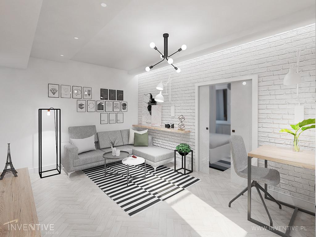 Loftowy salon z jasną cegłą na ścianie