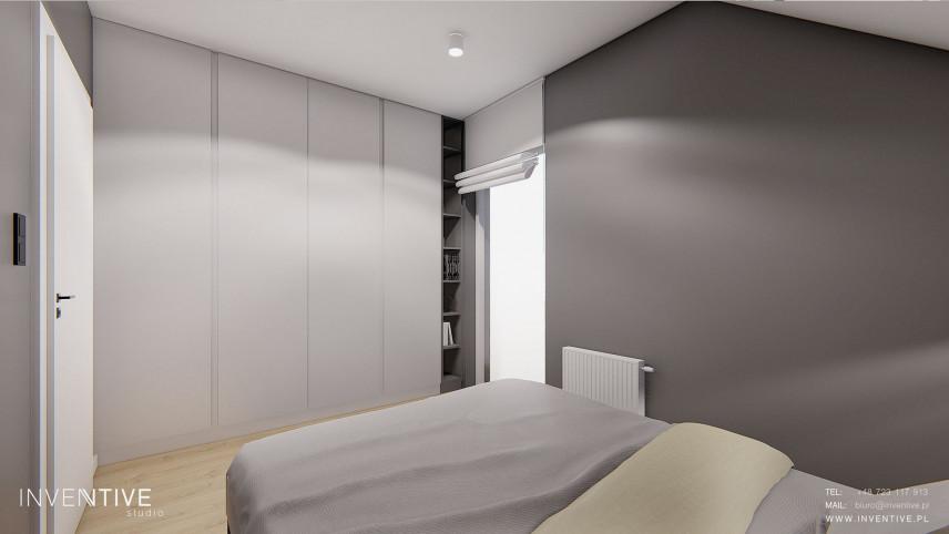 Szara sypialnia ze skosami