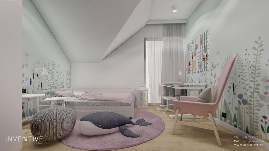 Miętowo-wrzosowy pokój z fotelem typu uszak