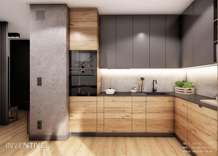 Projekt kuchni z szarymi i drewnianymi frontami.