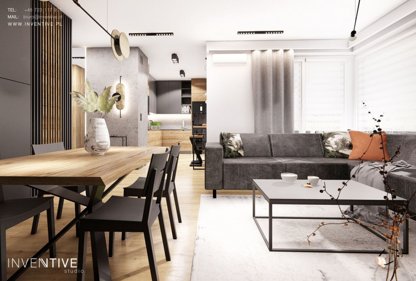 Aranżacja salonu i jadalni z elementami drewna