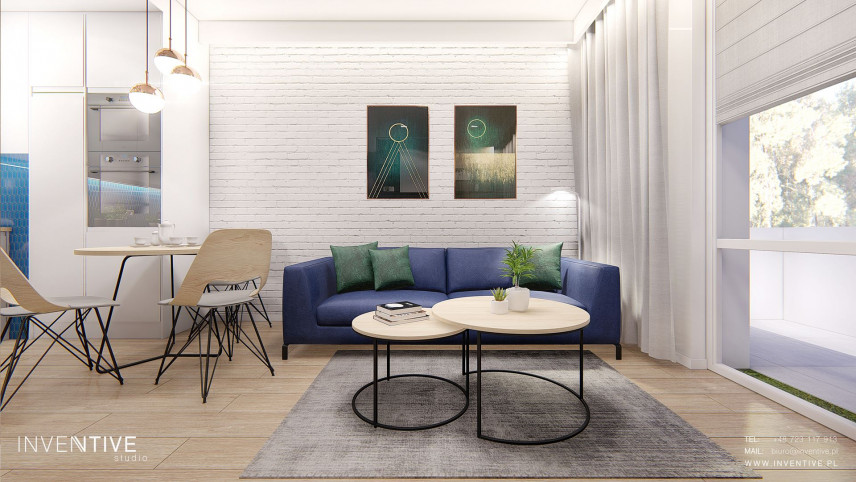 Projekt salonu z białą cegłą na ścianie