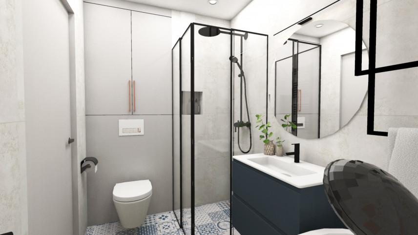 Aranżacja łazienki z prysznicem i wzorzystą podłogą