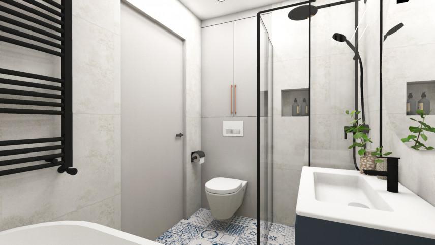 Aranżacja łazienki z czarnym grzejnikiem