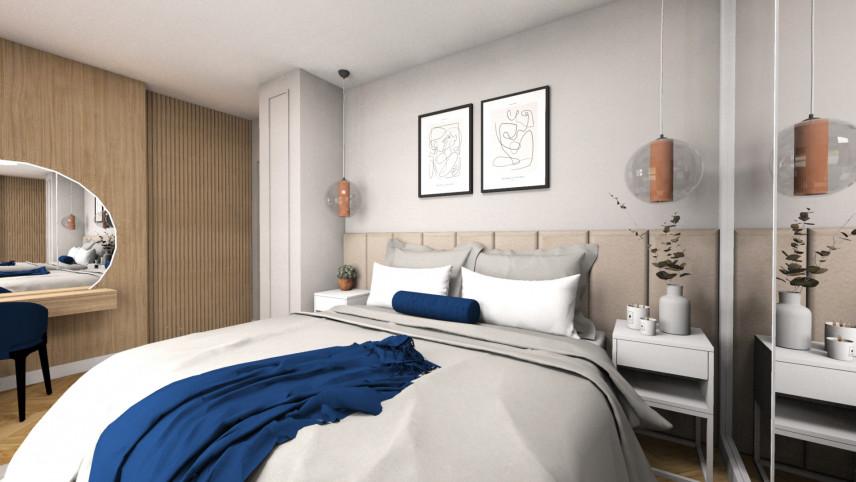 Aranżacja sypialni z drewnianą ścianą i toaletką