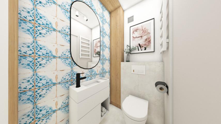 Aranżacja łazienki z jasnymi płytkami ze wzorem
