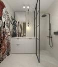 Mała łazienka z grafiką wodorostów na ścianie