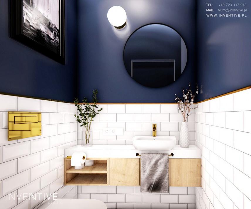 Projekt łazienki z obrazem w czarnej ramie