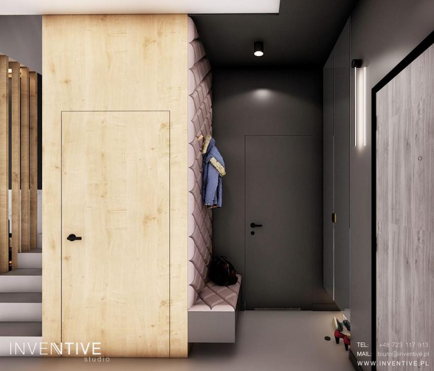 Projekt szarego przedpokoju z drewnianą szafą