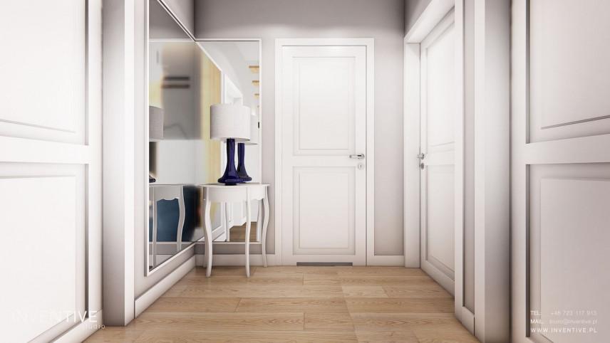 Aranżacja przedpokoju ze stylową białą szafką