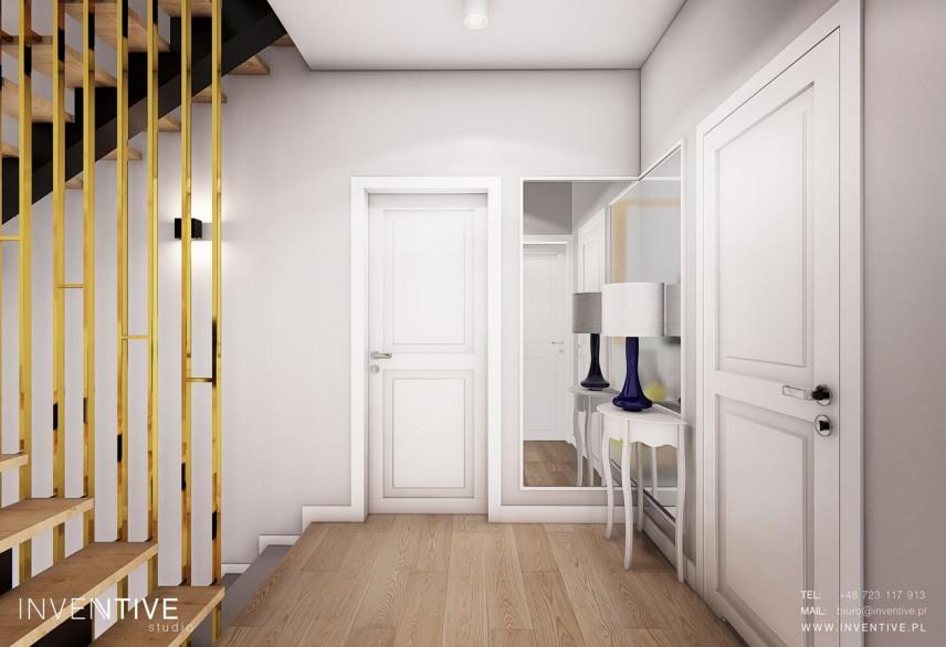 Aranżacja małego korytarza ze stylową szafką w stylu skandynawskim