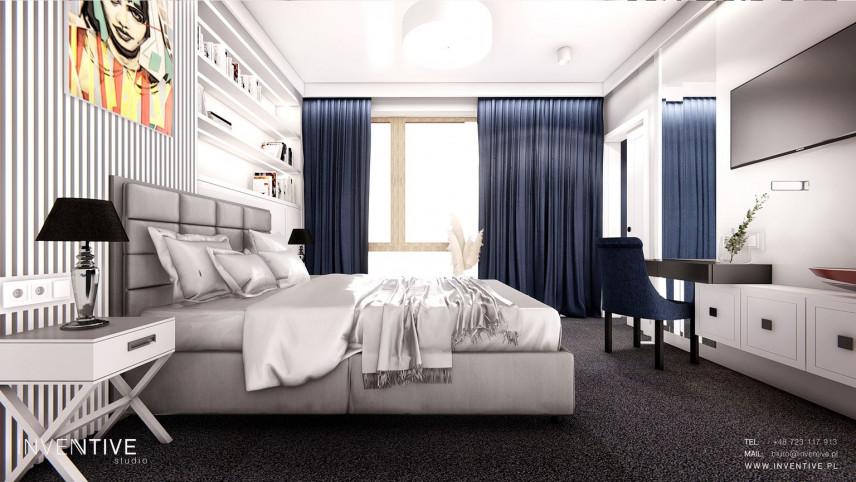 Sypialnia z granatowymi zasłonami
