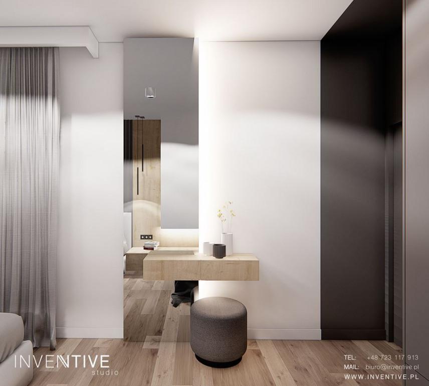 Aranżacja sypialni z drewnianą toaletką