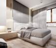 Aranżacja sypialni z dużym, szarym łóżkiem kontynentalnym