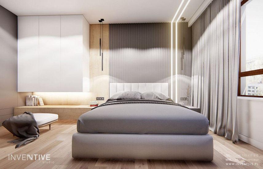 Sypialnia z szarym łóżkiem kontynentalnym