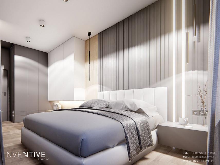 Sypialnia z szarymi panelami dekoracyjnymi na ścianie