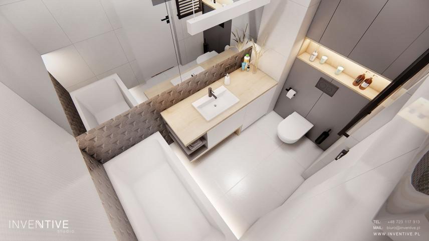 Łazienka z szarą ścianą
