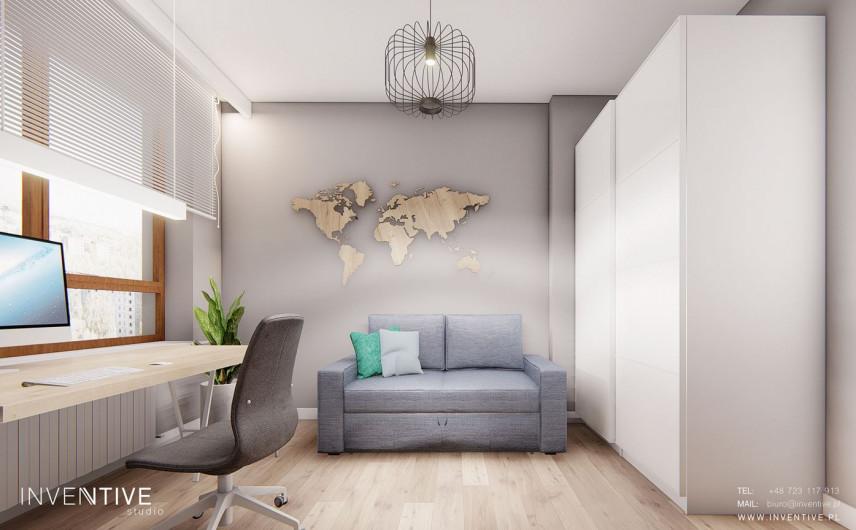 Aranżacja biura w domu z mapą na ścianie