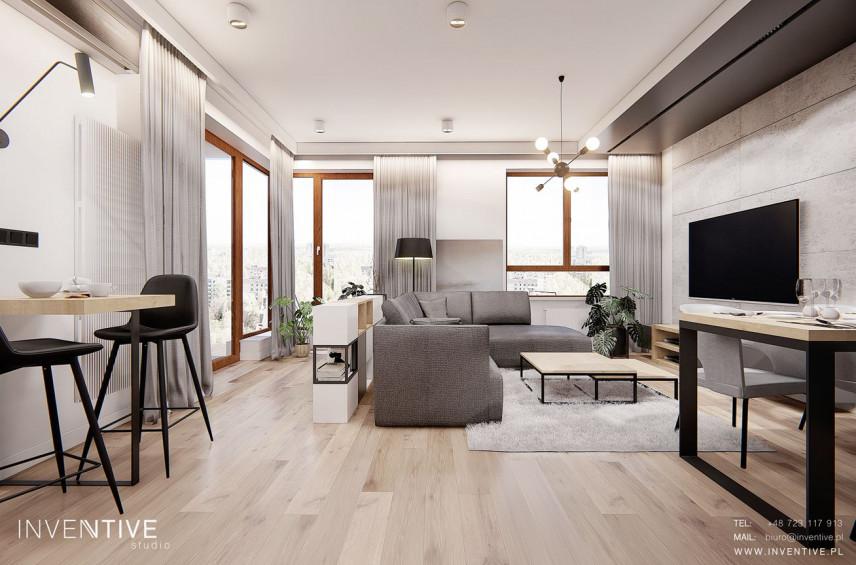 Salon z jasnymi panelami i miękkim jasnym dywanem