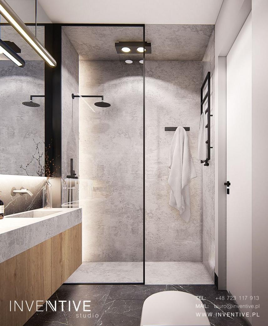 Łazienka z betonem dekoracyjnym na ścianie