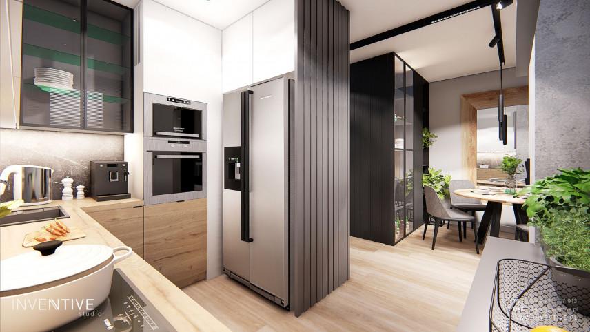 Aranżacja małej kuchni w zabudowie z drewnianym blatem
