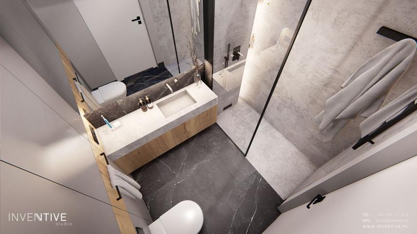 Aranżacja łazienki z betonem architektonicznym na ścianie