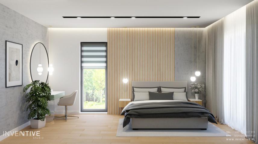 Nowoczesna sypialnia z betonową ścianą