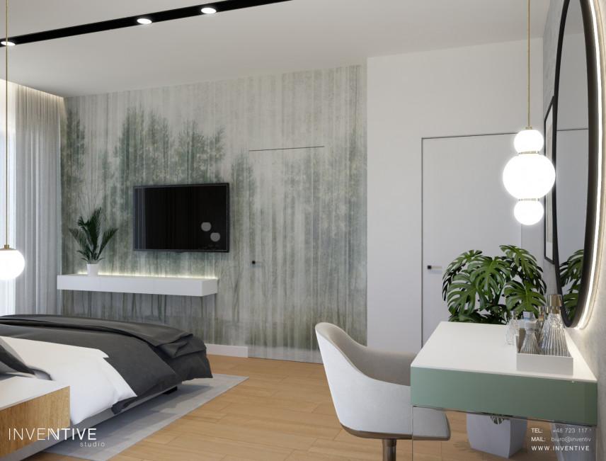 Sypialnia ze ścianą z tapetą w motywy roślinne